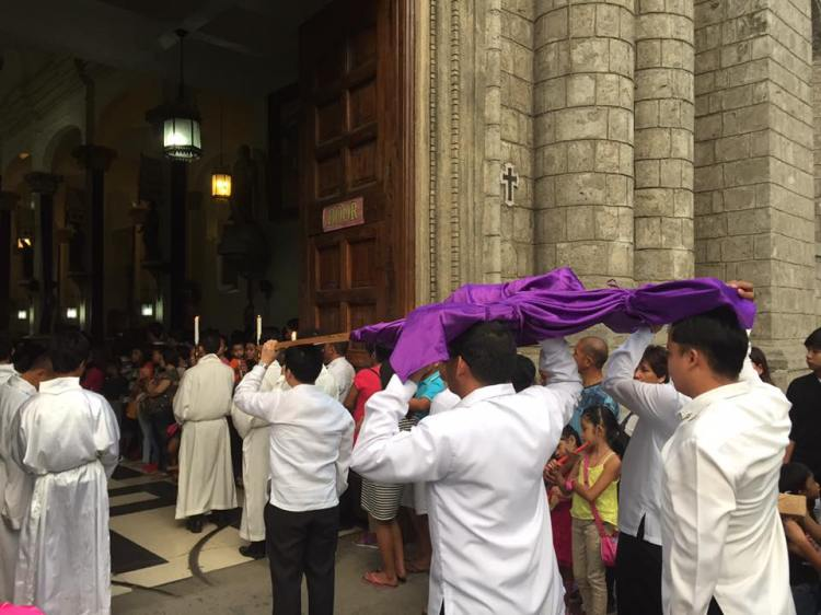 Cross being brought into the Church